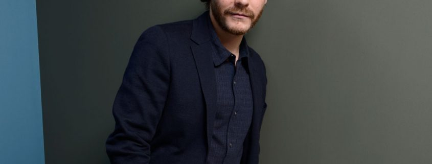 Daniel Bruhl modelling for camera